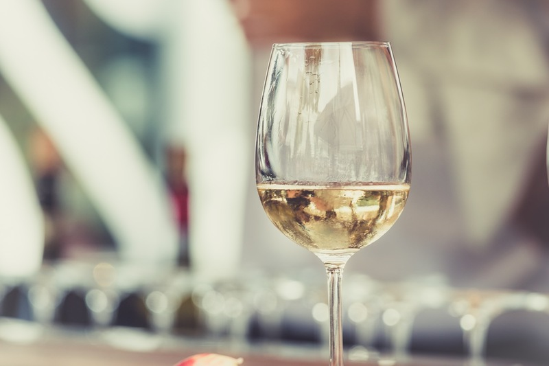 Enjoy a glass of the local white wine.