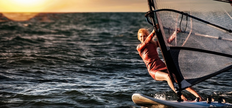 Windsurfing Holidays in the UK & Europe H2 Goboony Windsurf Woman Sunset Sea