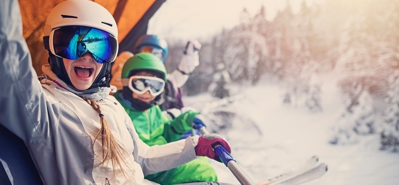 Best Places for Ski Holidays UK H2 Children Skiing Trees Snow Sun