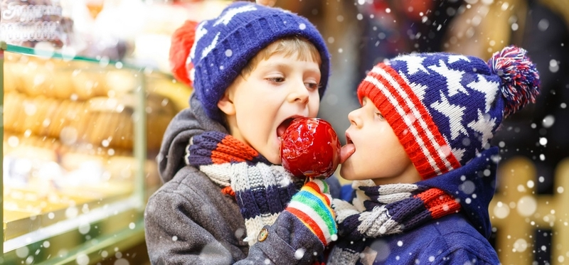 Best Christmas Markets in England H2 Kids Apple Snow Eating Knitted
